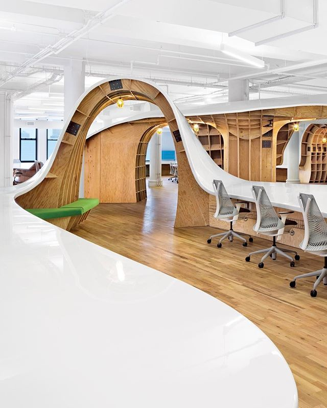 For this week's #idpicks contest, we're asking you to submit your best images of innovative offices! Tag your images with #idpicks and our editors will repost their favorites on Instagram and InteriorDesign.net this week. Pictured here, @CliveWilkinson Architects designed Barbarian Group's office with a continuous communal desk of clear resin poured over painted MDF that flows for 1,100 linear feet, seating up to 175. 📸: Michael Moran/Otto. @sandow
