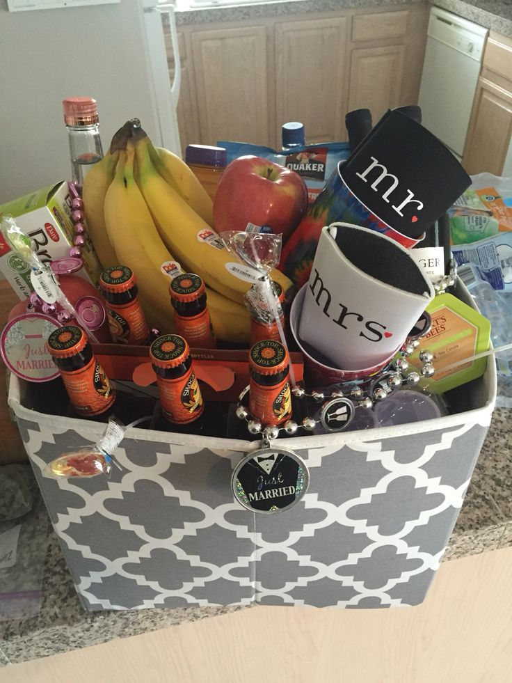 "Vegas Honeymoon Gift Basket:  Collapsible Crate - Walmart $5  Bottom is filled with 28 water bottles   Booze: 2 bottles of wine, 6 pack of beer, fifth of Vodka   Half gallon of juice mixer   Snacks - gluten free in this case  Fresh fruit-- bananas, apples, & strawberries   Decorative plastic cups (for consuming beverages on the strip)   Mr & Mrs beer coozies - Amazon   Beaded ""Just Married"" necklaces - Party City"
