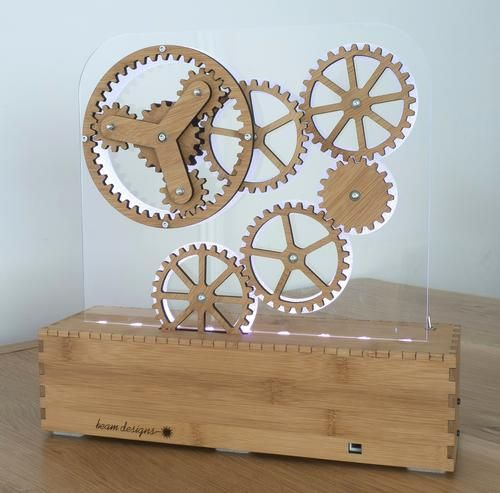 Laser cutting wooden gears << #craftylaser Sandwiched between a couple layers of acrylic? Nifty desk toy.