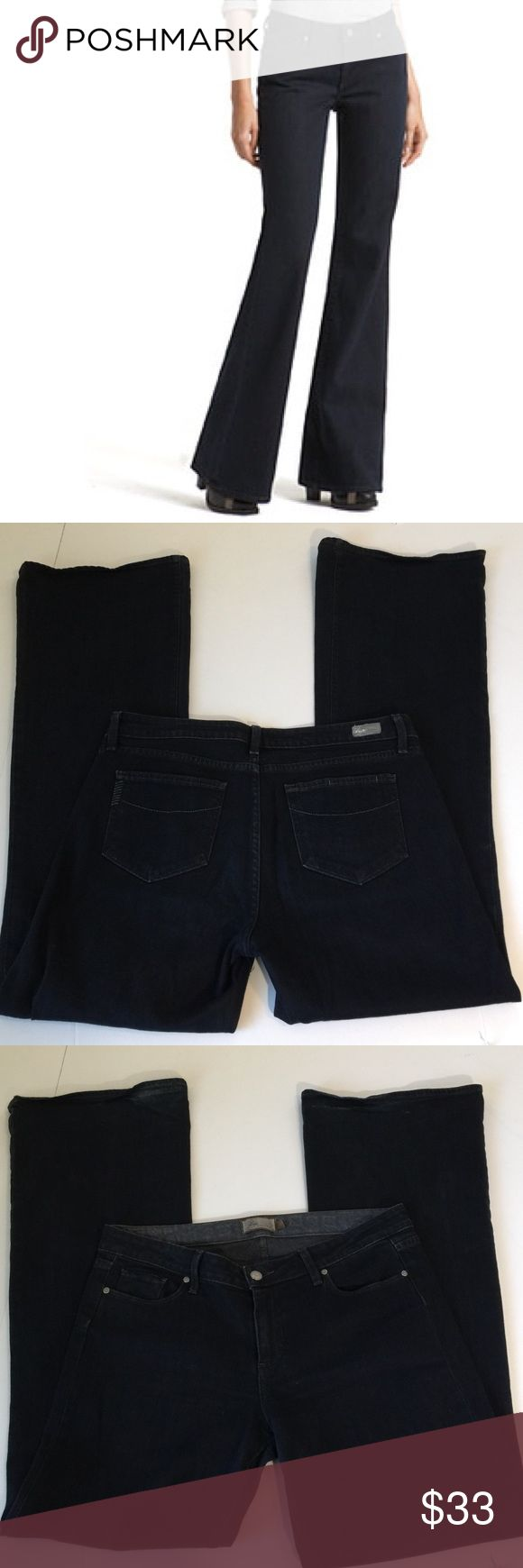 Paige Robertson Plus Size Flare Jeans, size 32 Paige Robertson Miss Rise Relaxed Wide Leg Flare Jeans in Plus Size 32. Flat lay measure of the waist is 18. Rise is 9.5, inseam is 35, and leg opening is 12. Made from98% cotton and 2% spandex. Color is a very dark wash blue. Slight distress by hems but is in otherwise excellent condition. Please ask if you have any questions. Paige Jeans Jeans Flare & Wide Leg