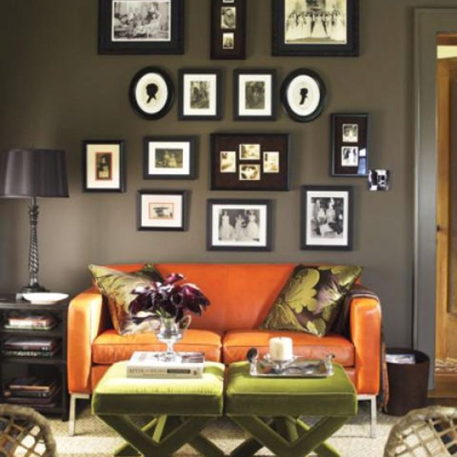 Dark green brown living room with orange couch orange for Dark green living room