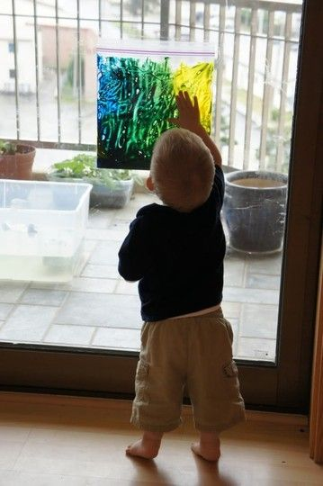 Love this!  Just put finger paint in a plastic ziploc bag, tape to the window, and enjoy hours of painting with NO MESS!