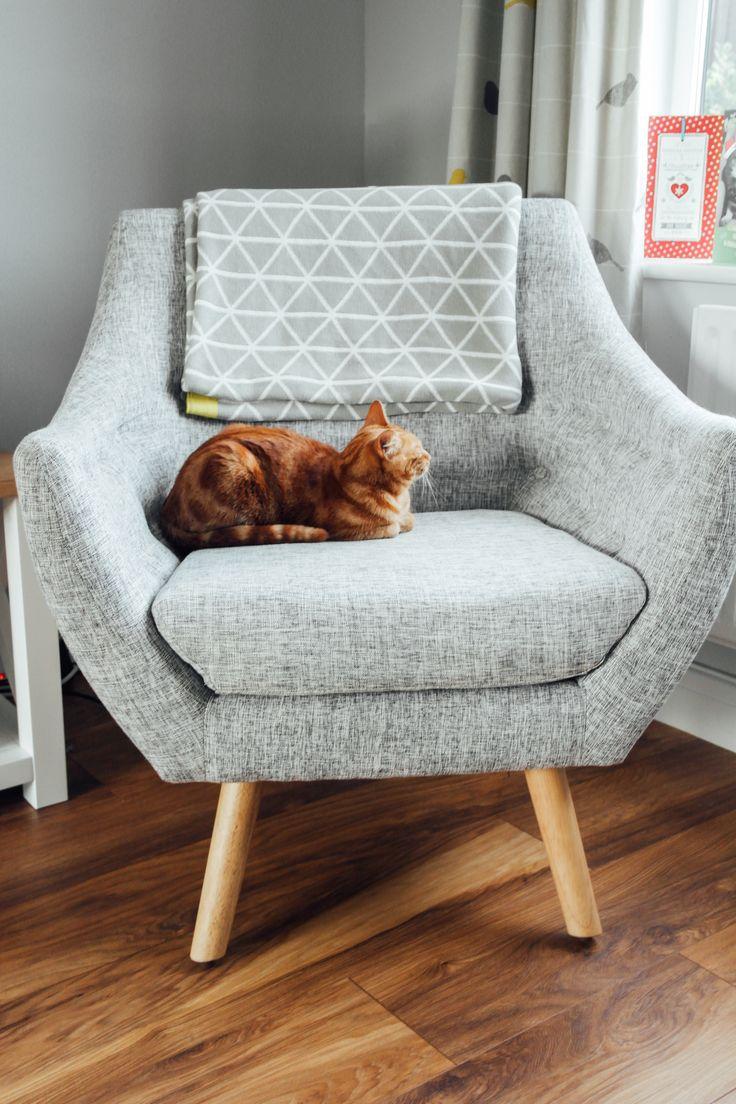 Grey living room with yellow accents. Scandinavian design. Finn Juhl inspired chair