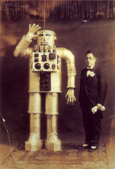 portrait of mitsui yasutaro + his robot • ca. 1930