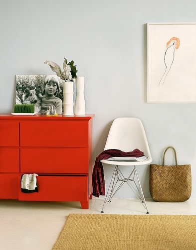 Bright dresser against neutral wall    [unknown source]