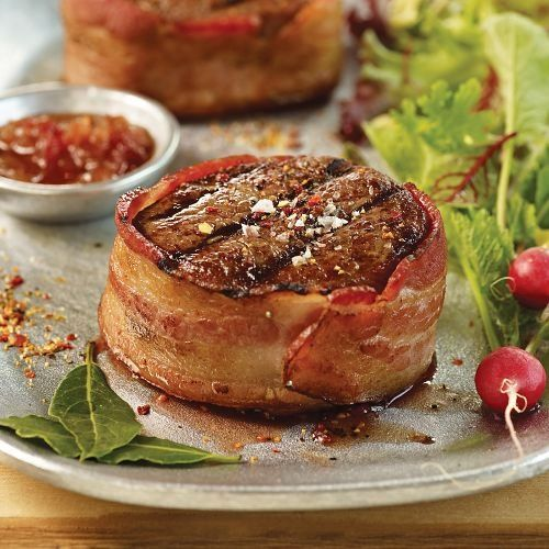 Join the bold, beefy flavor of Omaha Steaks Top Sirloins and the mouthwatering flavor of bacon and you've got a sizzling steak sensation. Our Top Sirloins Omaha Steaks 4 (5 oz.) Bacon-Wrapped Top Sirloins
