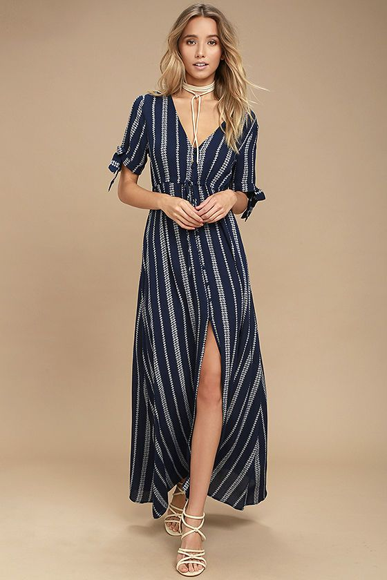 Lulus Exclusive! Everything will be a-ok the second you slip into the Sun-Kissed Days Navy Blue Striped Maxi Dress! Gauzy woven rayon, in a navy blue and white striped print, shapes a V-neckline and short sleeves with tying cuffs. Drawstring waist and full covered button placket travels down the maxi skirt with front slit.