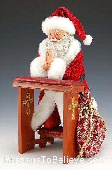 Giving Thanks Santa Kneeling And Saying His Prayers