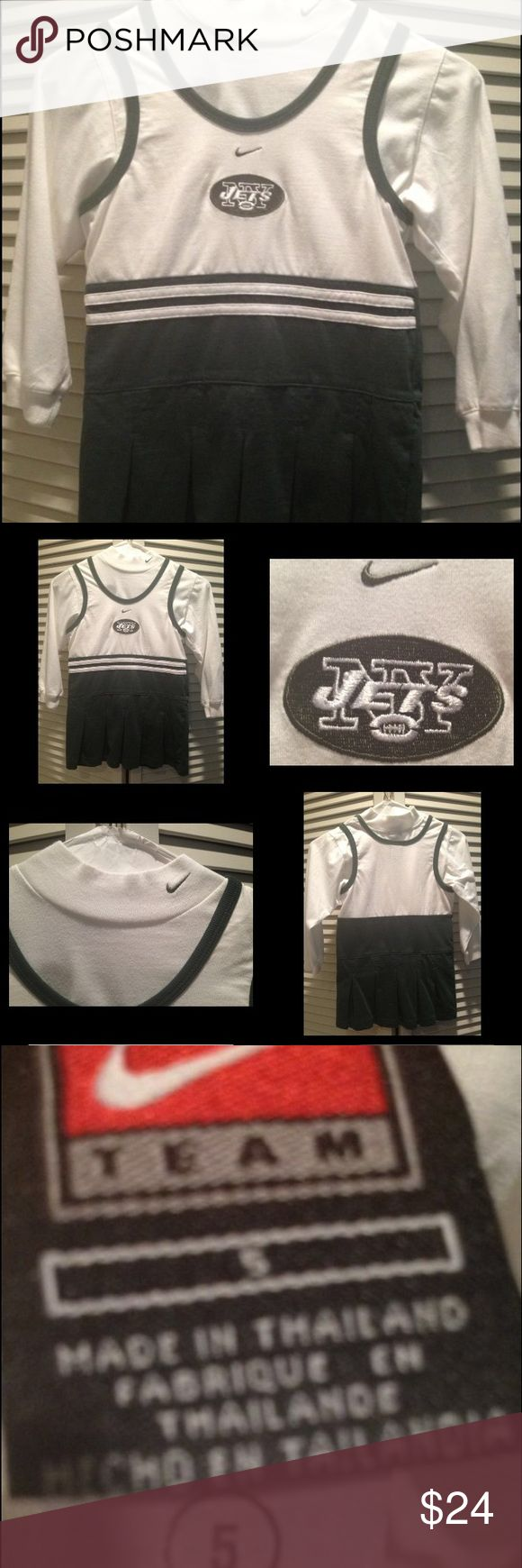 "GENUINE REEBOK NFL NY JETS  Girls DRESS MADE by TEAM Reebok! PRISTINE WHITE & NY JETS GREEN SIGNATURE COLORS  Cheerleader (or SUPERFAN) w/stylish extra details like striped banding under bodice & pleating on ""skirt"". Reebok NY Jets clothing =hi style, comfort & quality!   GENUINE ""JETS"" embroidered logo & REEBOK LOGOS on front of dress & REEBOK LOGO ON NECK OF TURTLENECK =athletic appeal & authenticity! Pleated details on jumper, banding around neck & striping at waist! Jumper: 60% COTTON…"