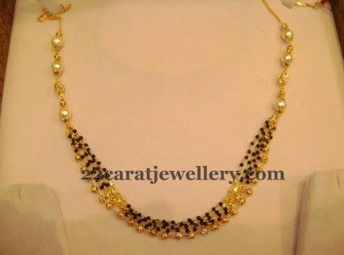 Love this four layer black bead necklace with a layer of gold bead chain complimenting pearls.. wow