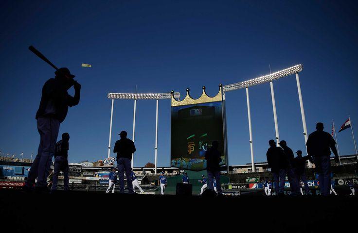 MATT SLOCUM—AP Oct. 21, 2014. Kansas City Royals warm up before Game 1 of baseball's World Series against the San Francisco Giants Tuesday in Kansas City, Mo.