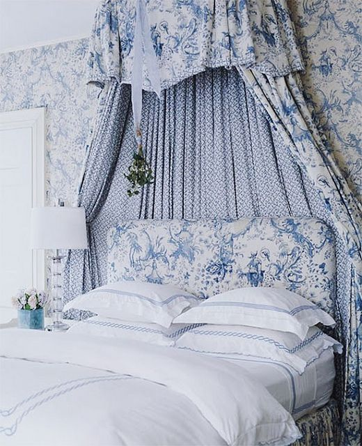 I love #BlueAndWhite #Toile fabrics with checks and tiny prints.  This is a delicately #FrenchDesign look with the fabric drape behind the headboard.   I like the simple white linens and monogram pillow with the busy fabric and wall paper patterns.  It's easy to mix prints when the colors are simple.  I want to curl up in bed with hot tea, a hotter French novel and an even hotter red headed English Prince!  Is that #mistletoe?