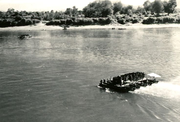 Transporting mules and WWII soldiers across the Irrawaddy River south of Myitkyina. Photographer Amer