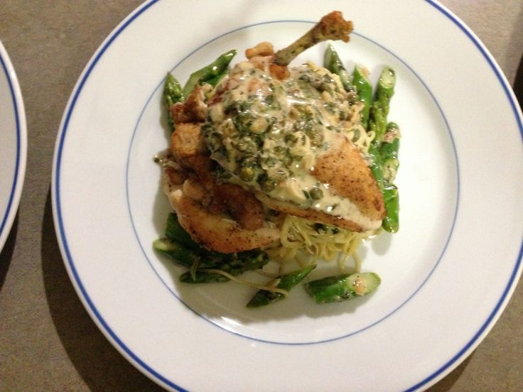 Angel hair pasta, asparagus, airline chicken breast with a white wine, lemon, caper butter sauce.