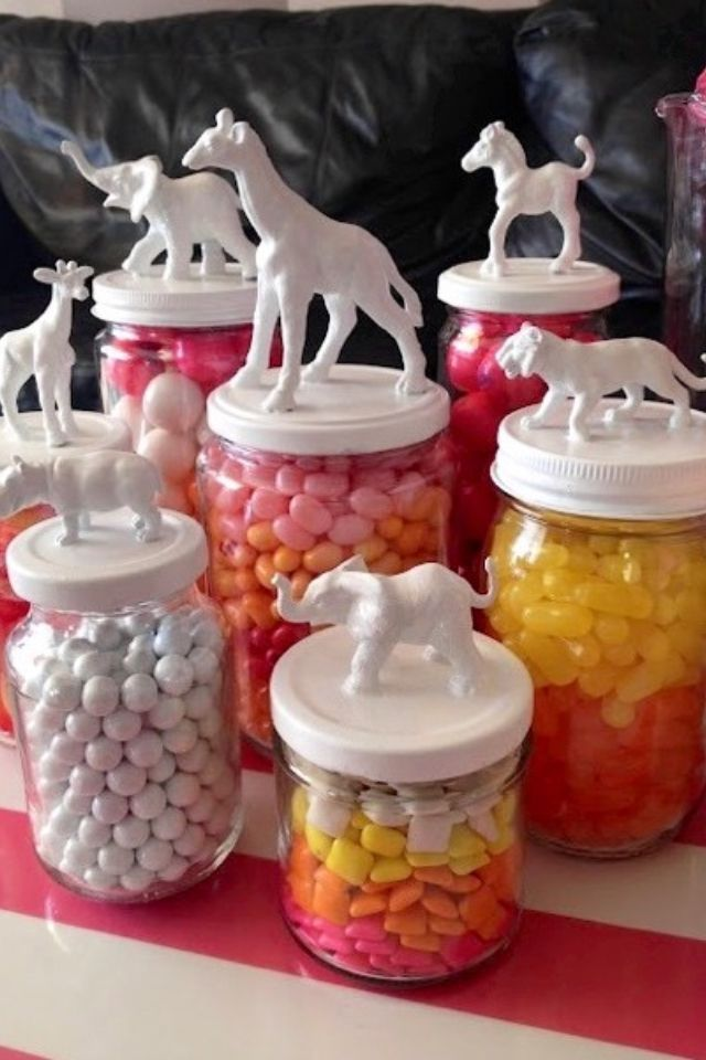 Cute! Plastic animal toys super-glued to the top and then spray-painted. :)