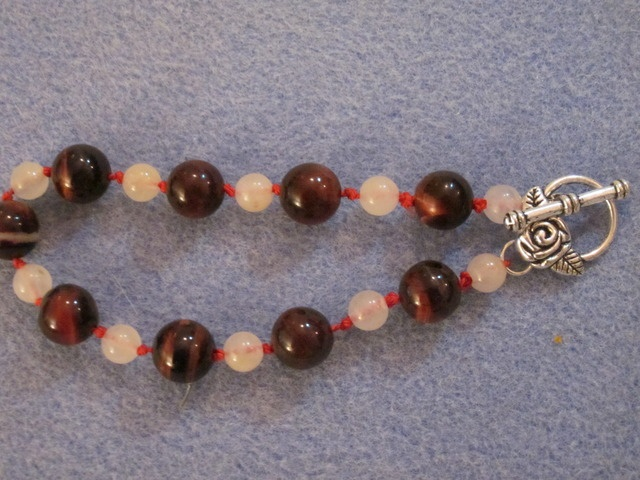 'Hand-knotted gemstone bracelet' is going up for auction at  2pm Fri, Jun 29 with a starting bid of $10.  Just listed my second item!