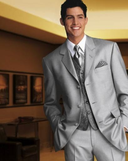 SILVER TUXEDO (GROOMSMEN)----BUT W/ ROYAL BLUE TIE AND HANKY------GROOM TUXEDO ALSO BUT W/ ROYAL BLUE TIE, VEST, AND HANKY