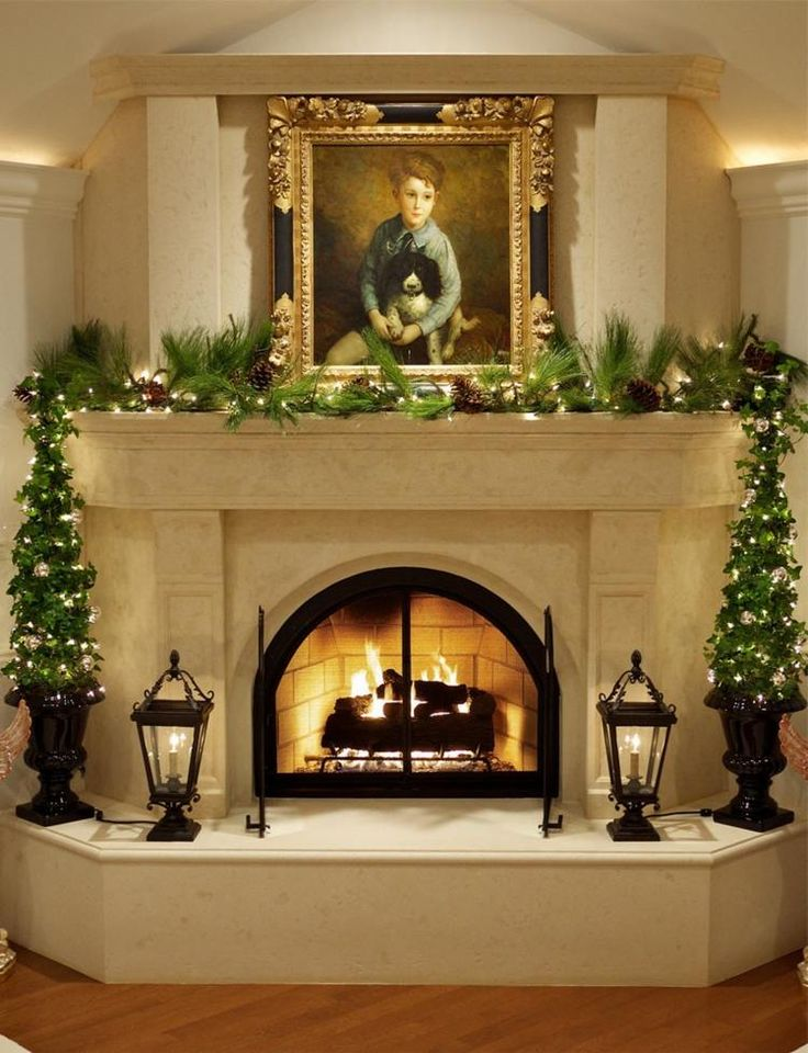 Elegant Beige Marble Mantel Fire Place With Small Christmas Trees  Decoration And Floor Lanterns Also String Lights Below Picture Frame