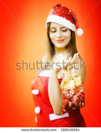Magic Christmas Gift Holding By Beautiful Girl Foto Stock: 166546064 : Shutterstock