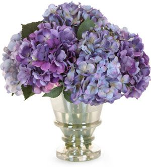Silk hydrangea flower arrangement in hues of purple and blue. See more purple wedding inspiration: http://www.squidoo.com/purple-themed-wedding