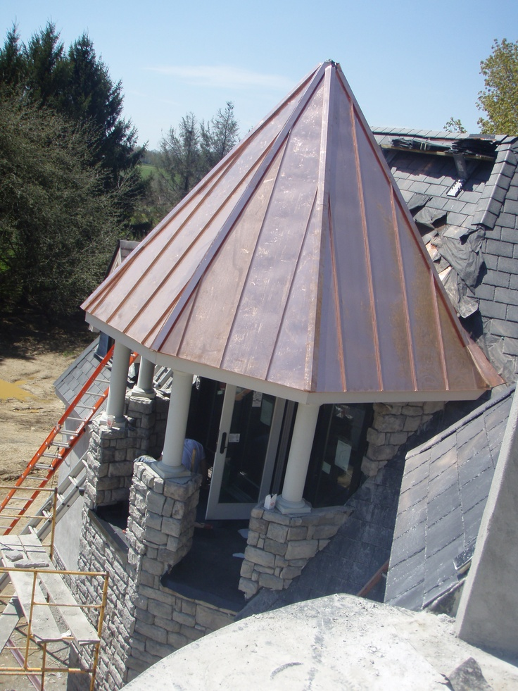 Hexagonal silo copper standing seam roof metal roofing for Copper standing seam roof