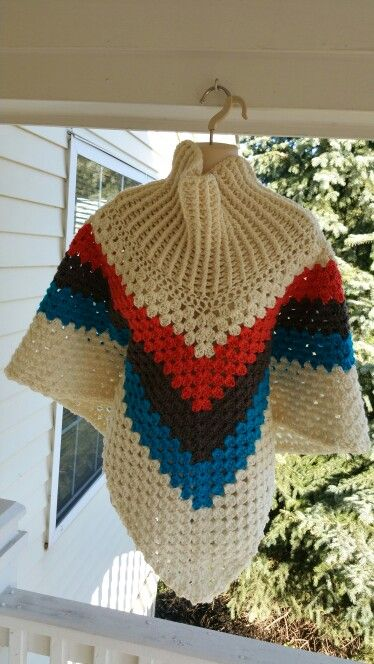 Hot Off My Hook! Project: Cowl-Neck Poncho Started: 15 Oct 2015 Completed: 17 Oct 2015 Model: Madge the Mannequin Crochet Hook(s): 7mm Yarn: Redheart Super Saver, Redheart Super Saver Accent Color(s): Aran, Coral, Putty, Pool Pattern Source: Simply Crochet Magazine Issue No. 25 Pattern Designed By: Simone Francis Notes: This is my 38th Cowl-Neck Poncho!