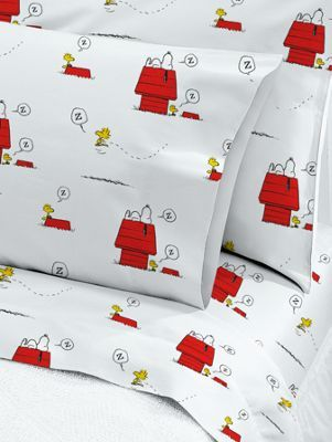 Snoopy and Woodstock cotton percale sheet set pays tribute  to the 65th anniversary of the original Peanuts comic strip. 200-thread-count. Made in Portugal.