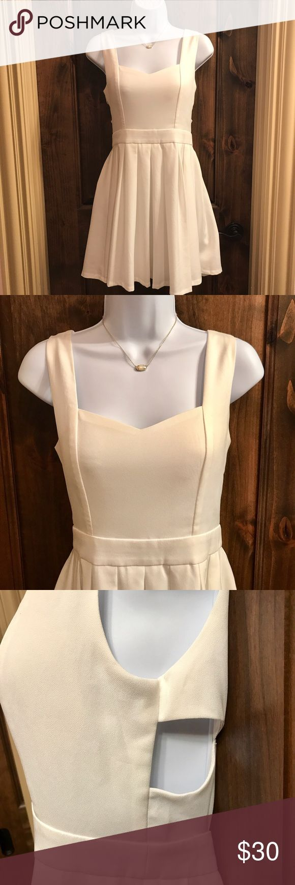 Tea & Cup White Cut Out Dress This super cute white dress is perfect for any occasion! The heart-shaped key hole back and cut outs around the waist make it super fun and flirty! Only worn once. Tea n Cup Dresses Mini