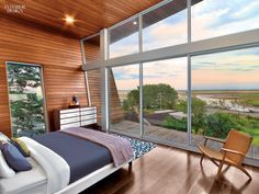 25 Simply Amazing Country Homes | Aluminum-framed glass fronts the master bedroom in this Cape Cod house by Hariri & Hariri.