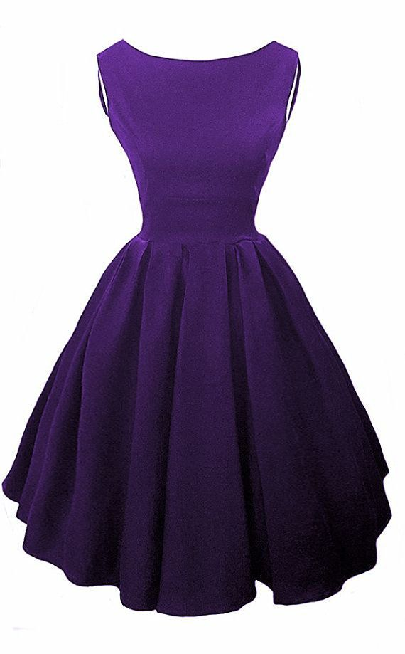 Elegant Audrey Hepburn inspired Purple 50s Dress, which has a high neck line at the front with a V in the back, with concealed central back