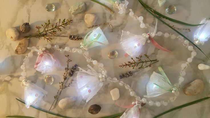 These fairy lights are a product of White Feather Designs. Pastel coloured lights. https://www.facebook.com/whitefeatherdesignshomedecor/