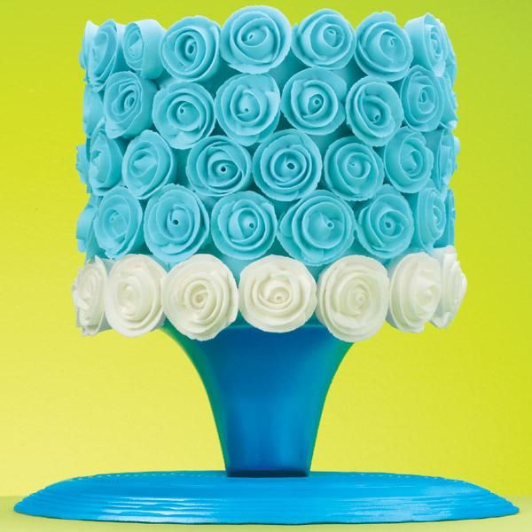 """""""Blue and White Ribbon Roses Cake"""" Impress family and friends with a cake covered in wonderful ribbon roses. http://idomagic.com/magic-show-descriptions/"""