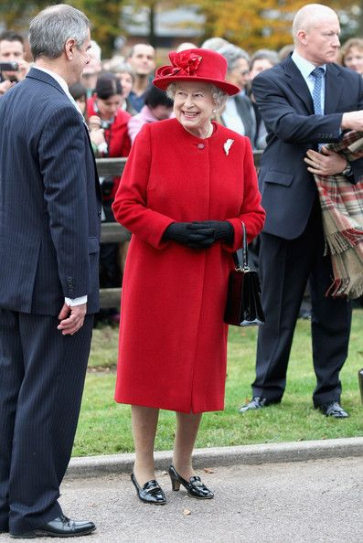 Queen Elizabeth II smiles as she visits Newmarket Animal Health Trust on October 29, 2009 in Newmarket, England.