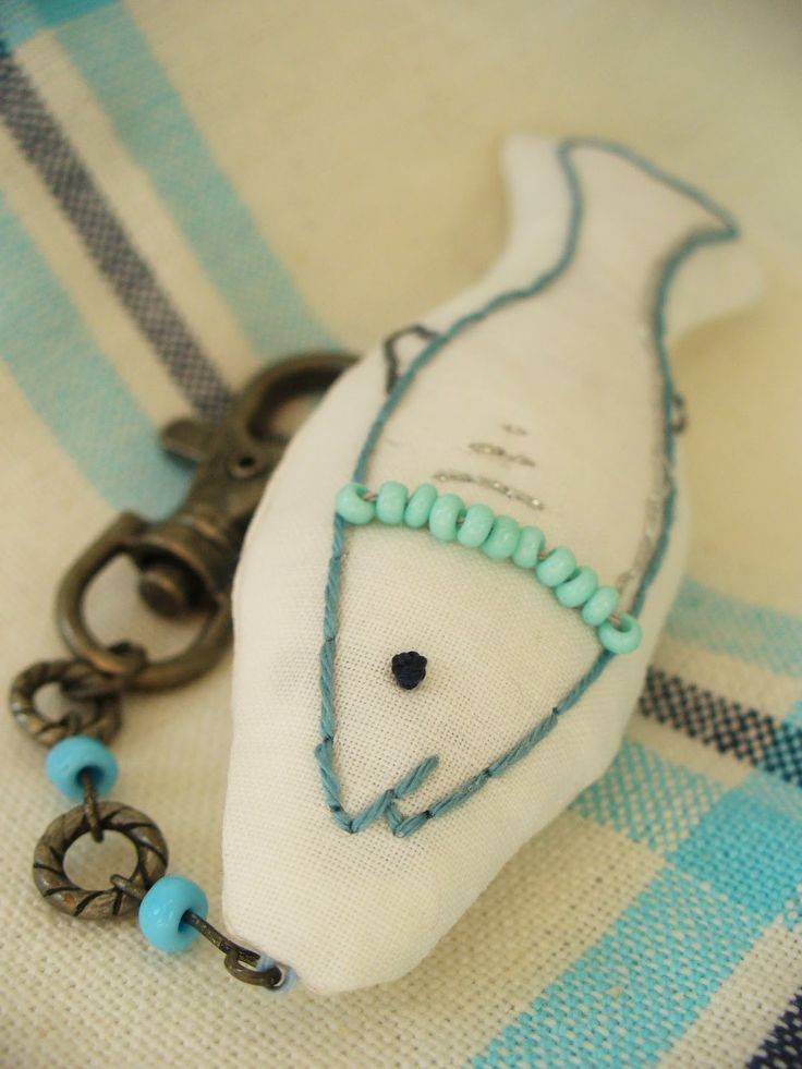 Embroidered fish and a key ring combined.
