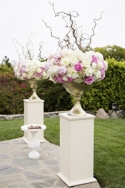 Stunning floral decor: http://www.stylemepretty.com/little-black-book-blog/2014/12/15/elegant-spring-malibu-wedding/   Photography: Catherine Hall - http://www.catherinehallstudios.com/
