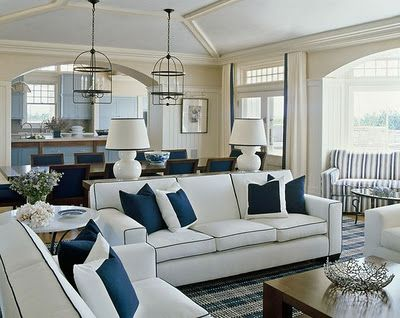 Crisp color palette of navy and white creates a traditional  Hampton beach style living room 87 best seasideInspired com brings you into Living Rooms