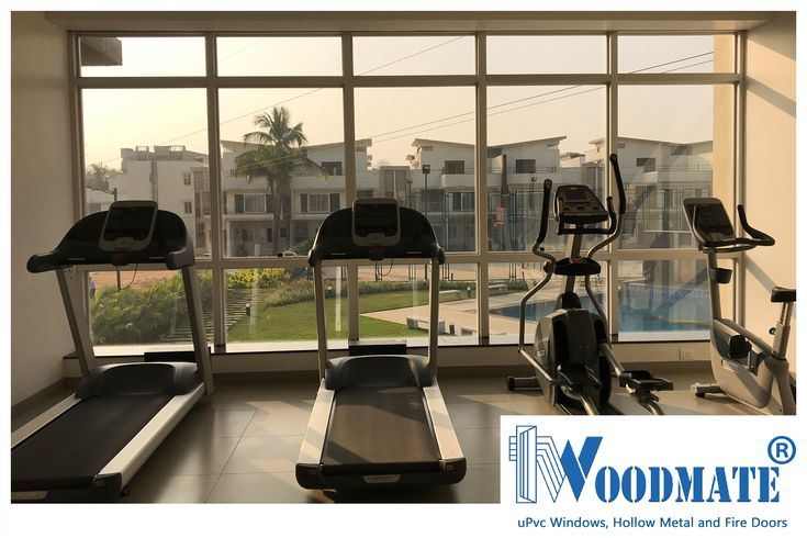 These full length WoodMate facade uPVC windows at the Gym, offers you an opportunity to appreciate the view in front. Add #WoodMateWindows to your homes.  #Gym #Facade #uPVCWindows #upvcdoors  #upvcdoorsandwindows #Doors #windows #beautifulwindows #beautifuldoors #Beautifulhomes #interiors #architecture #Bangalore #DeccanWoodMate