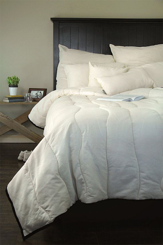 Trunk & Treadle --> Organic Wool Comforter // Organic Duvet // Organic Bedding   A handcrafted wool comforter for a cozy night's sleep. All of our wool comforters are filled with wool that comes from our very own flock of sheep. Check out our etsy shop to find out more!