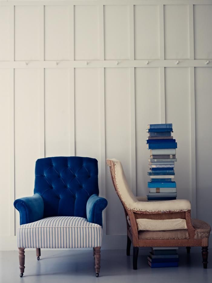 love the walls, love the chair, love the books, love it all!  Ian Making, chair upholstered in ticking fabric and velvet