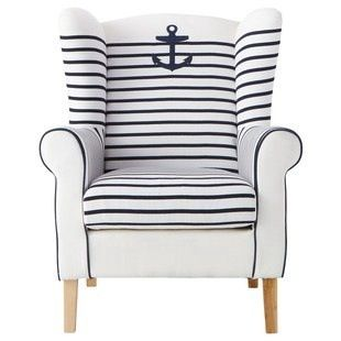 White, wing back chair with blue stripes and an anchor. Nautical.