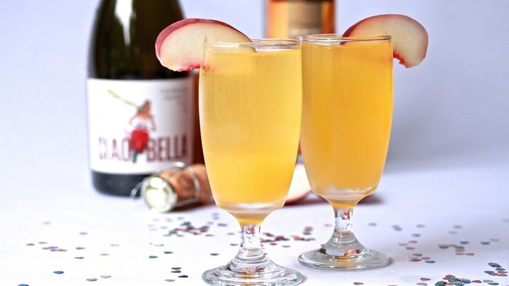 PEACH BELLINI: We have made it to New Years Eve 2015! Whatever your plan for tonight, by this afternoon you'll be thinking of cocktails to kick off the celebrations. And nothing says New Years like a sweet, delicious peach Bellini.Mixed with Peach Schnapps, Peach Puree, Agave Syrup and Prosecco. Recipe on the blog.