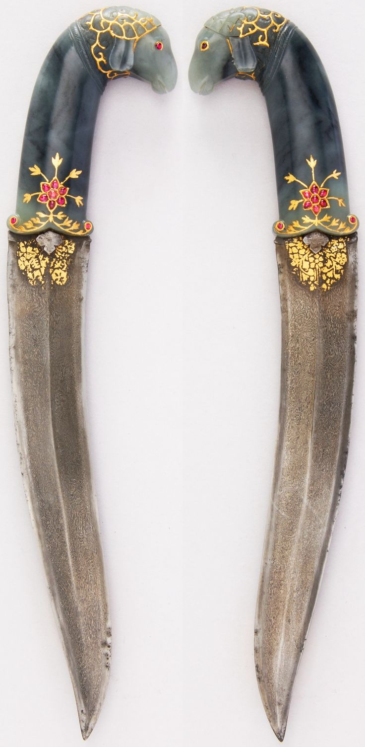 Persian khanjar dagger, (Indian hilt), 17th century, jade, ruby, gold Dimensions: H. 11 3/8 in. (28.9 cm); H. of blade 8 in. (20.3 cm); W. 2 1/8 in. (5.4 cm); D. 3/4 in. (1.9 cm); Wt. 7.4 oz. (209.8 g), Met Museum.