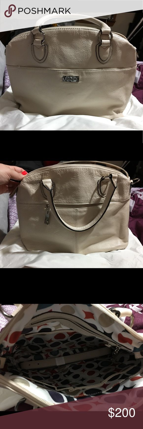 Grace Adele leather bag NWOT Grace Adele real leather purse. Never used. Longer strap included. Cream in color. Protective bag included. Wallet to match if interested. Purse has just been sitting in bag in closet. grace adele Bags Shoulder Bags