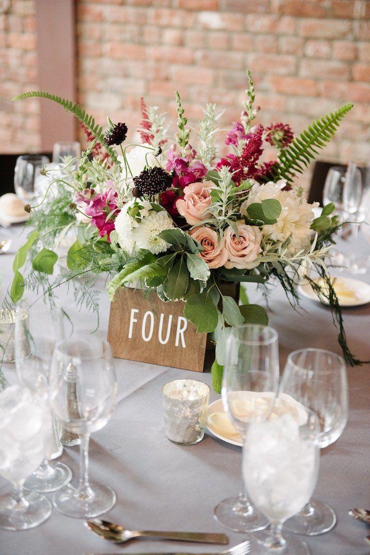Floral centerpiece in white, blush, raspberry and deep burgundy. Dark + Diamond Floral Design.