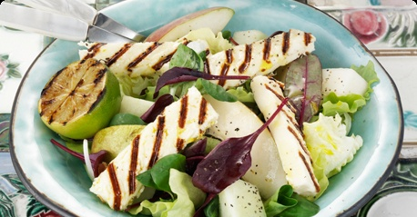 A honeydew melon & pear salad topped off with Apetina halloumi-style grill cheese