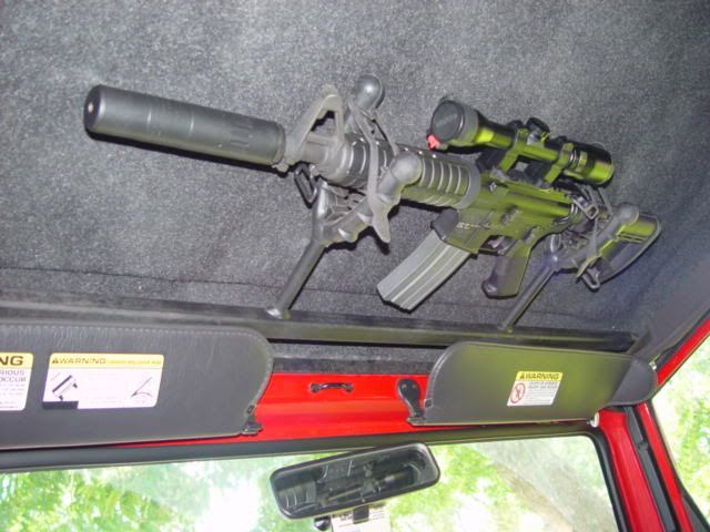 Wanna hide a gun in your car? Another custom roof mount for rifles.
