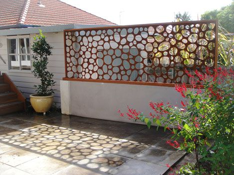 """corten steel """"stone"""" mimic wall, look at the stone shadows it casts on the otherwise bland concrete.  What a great idea! I've never thought of using a wall or fence to create a shadow pattern. landscape architecture"""