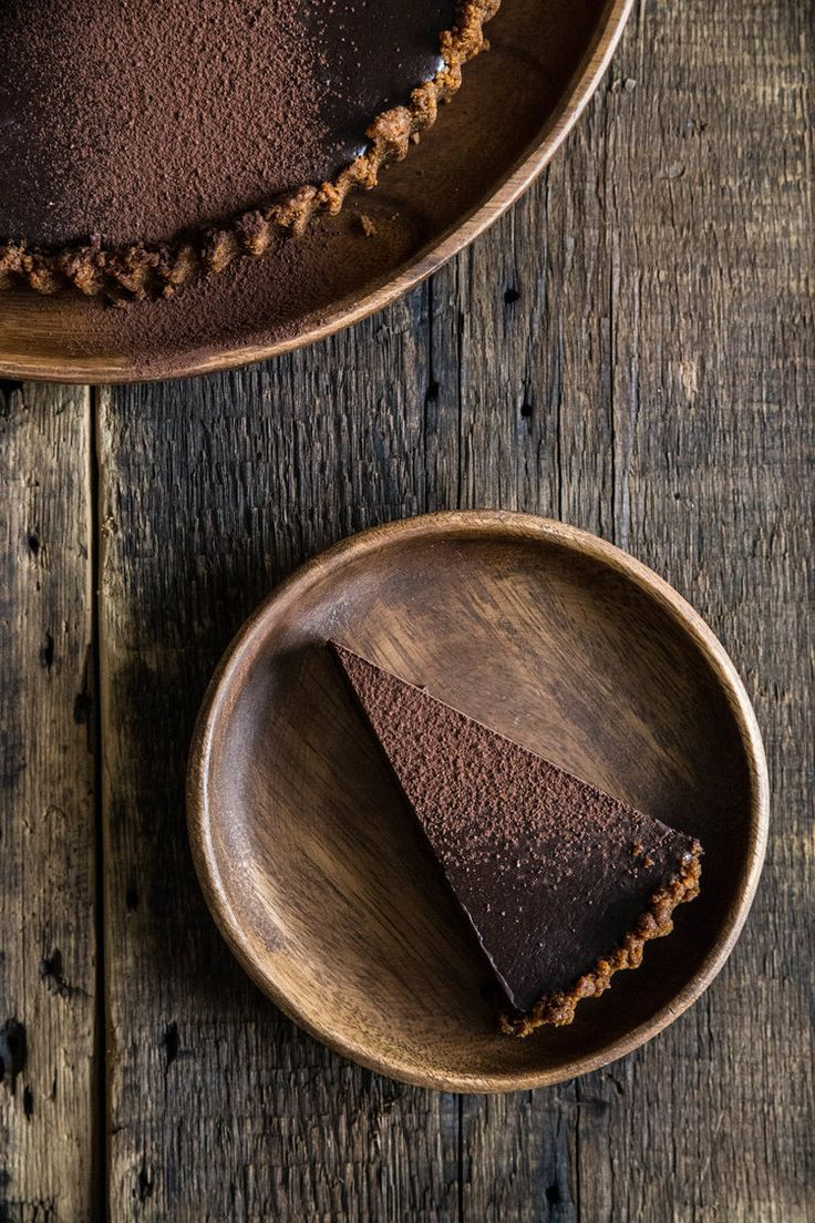 Chocolate Gingersnap Tart (crust of gingersnap cookies and butter, filling of 3/4 c cream, 3/4 c milk, 10 oz chocolate, 1/3 c brown sugar, cinnamon, 2 eggs...)