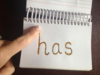 Tactile Sight Word Books using glitter glue. Students can trace the glitter letters as they read the words.