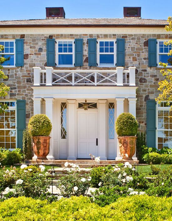 L.A. House: 'A Designer's Dream' - Traditional Home® Love the turquoise shutters with the stone.
